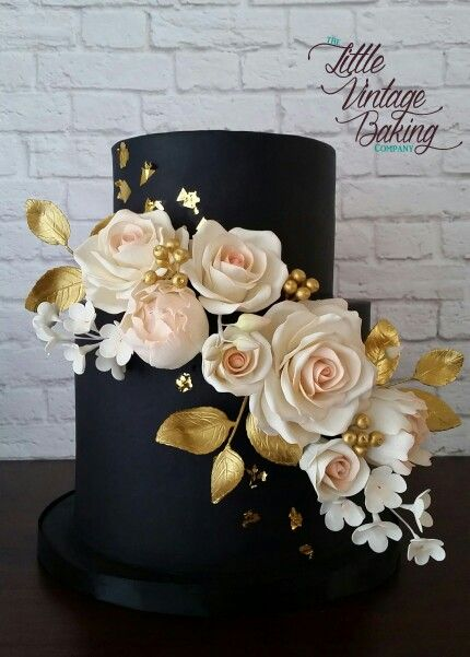Black, gold and blush wedding cake with sugar roses, peony buds, blossoms, berries and leaves by the Little Vintage Baking Company.