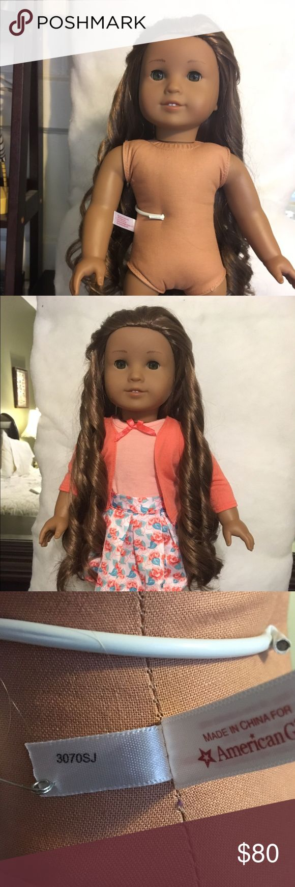 American Girl Doll American Doll Retired/ has been most of the time displayed/ she will make a little girl happy / smoke free home comes with one original American Girl outfit  / and one not ortigal which she's wearing on photo / smoke free home AMERICAN GIRL DOLL Other