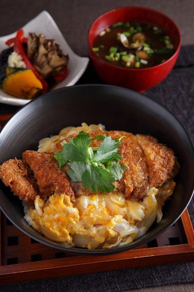 Katsudon - Japanese rice bowl with fried pork cutlet covered with a half-cooked egg