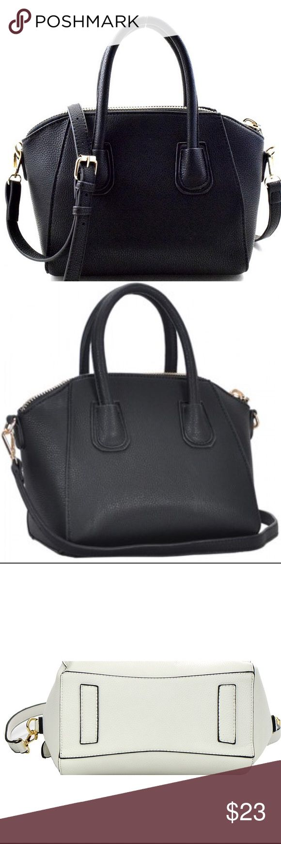 """New York style satchel handbag Black Welcome to New York! Well, maybe not, but this bag will give you that New Yorker flare. It has a double center that reveals a printed lining when opened up. The inside also has one large pocket that closes with a zipper, and two medium ones. The bag has two straps for grip and comes with an attachable shoulder strap.   Length 16""""  Width 6""""  Height 9"""" Bags Satchels"""