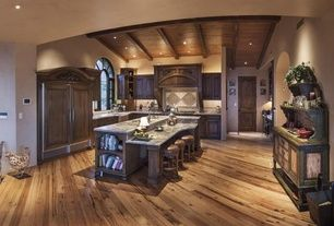 Mediterranean Kitchen with Complex granite counters, Flush, Stone Tile, L-shaped, Undermount sink, Farmhouse sink