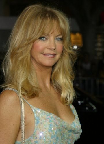 Goldie Hawn is 69 years old as of 2014. She wears it well. Or spent her money well. Either way, she looks great!