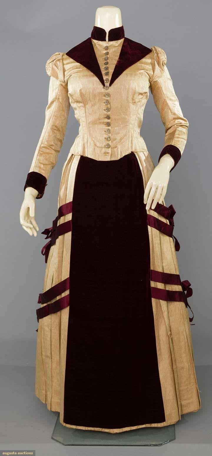 SILK BUSTLE DRESS, 1880-1890 tan watered silk, wine velvet & silk ribbon trims, figural metal buttons, brown cotton lining