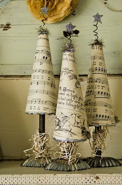 Christmas Trees made from old book papers, vintage tart tins and glitter: