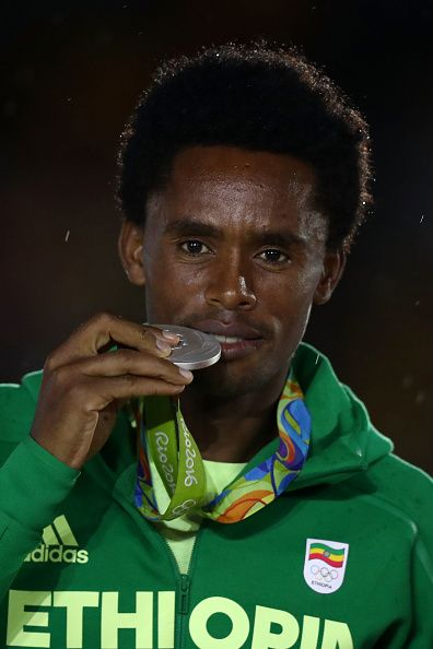 Silver medalist Feyisa Lilesa of Ethiopia stands on the podium during the medal…
