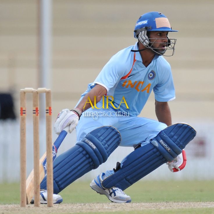 Shikhar Dhawan touches and turns for India | Aura Images ...