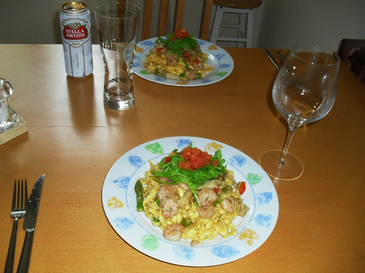 Tagliatelle with prawns and asparagus at home in Brixton London