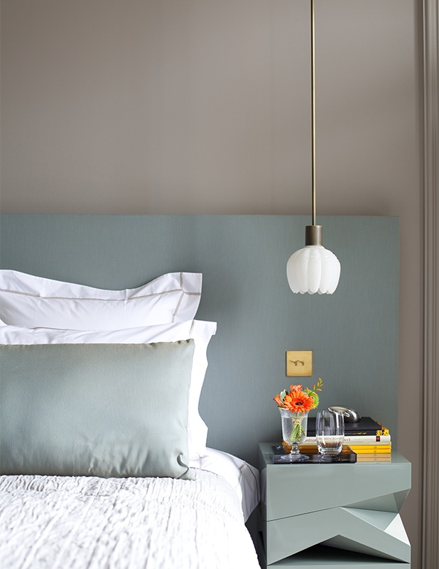 I like how the headboard extends past the bed to include the side table and the colour of the headboard being picked up in the pillow