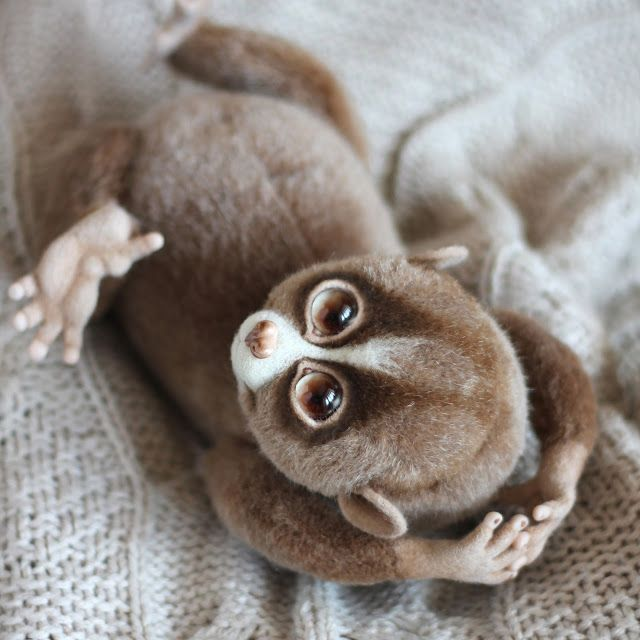 "Handmade stuffed toy ""Loris"".  Size: 18 cm.   Materials: plush, steel wire, wool, cotter-pins, glass eyes, plastic, glass granules."