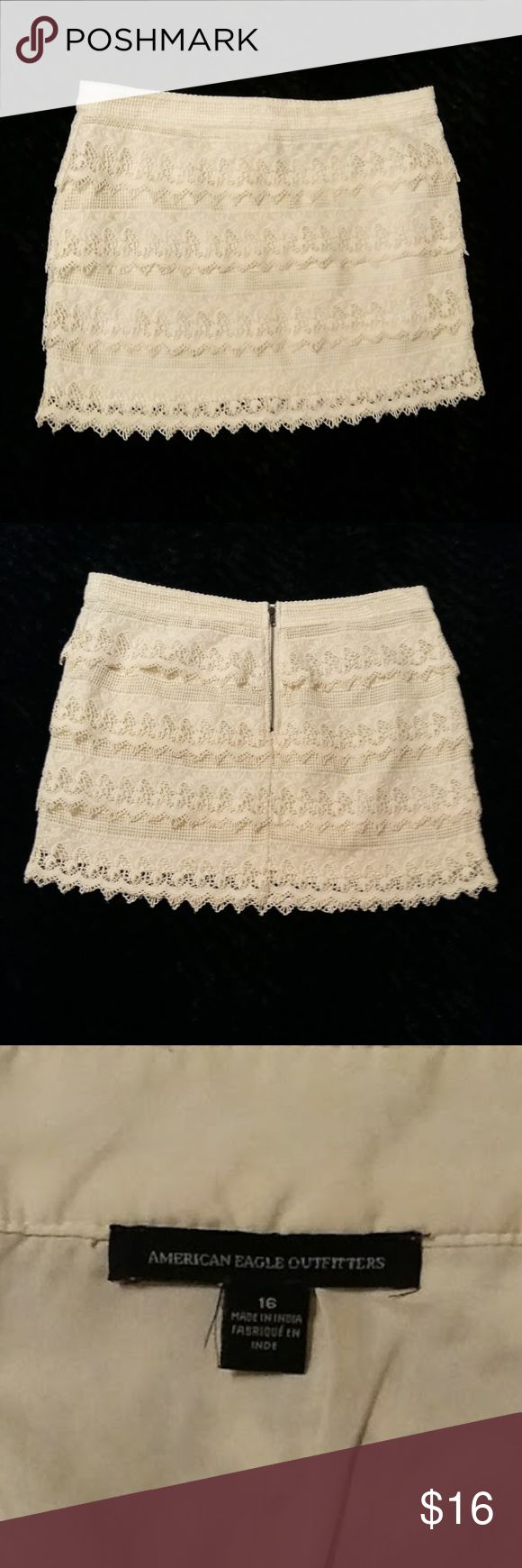 """[American Eagle] Tiered Mini Skirt (Size 16) BRAND:  American Eagle STYLE:  Tiered Lace Mini Skirt SIZE:  16 COLOR:  Cream MATERIAL:  100% Cotton (Inside)  100% Polyester (Outside) CONDITION:  Excellent INVENTORY:   Tiered crochet lace with two different patterns.    WAIST:  17 ½""""""""  LENGTH: 16""""  Measurements are approximate and taken laying flat! American Eagle Outfitters Skirts Mini"""