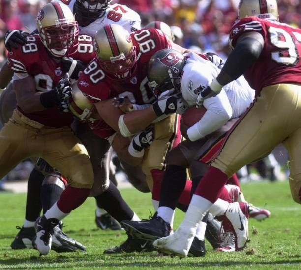 Tampa Bay Buccaneers 43 Jameel Cook Cq Gets Crunched By San Francisco 49ers Defense 98 Julian Peterson Far Left 90 Center Tra In 2020 49ers Vs Photo Stock Pictures