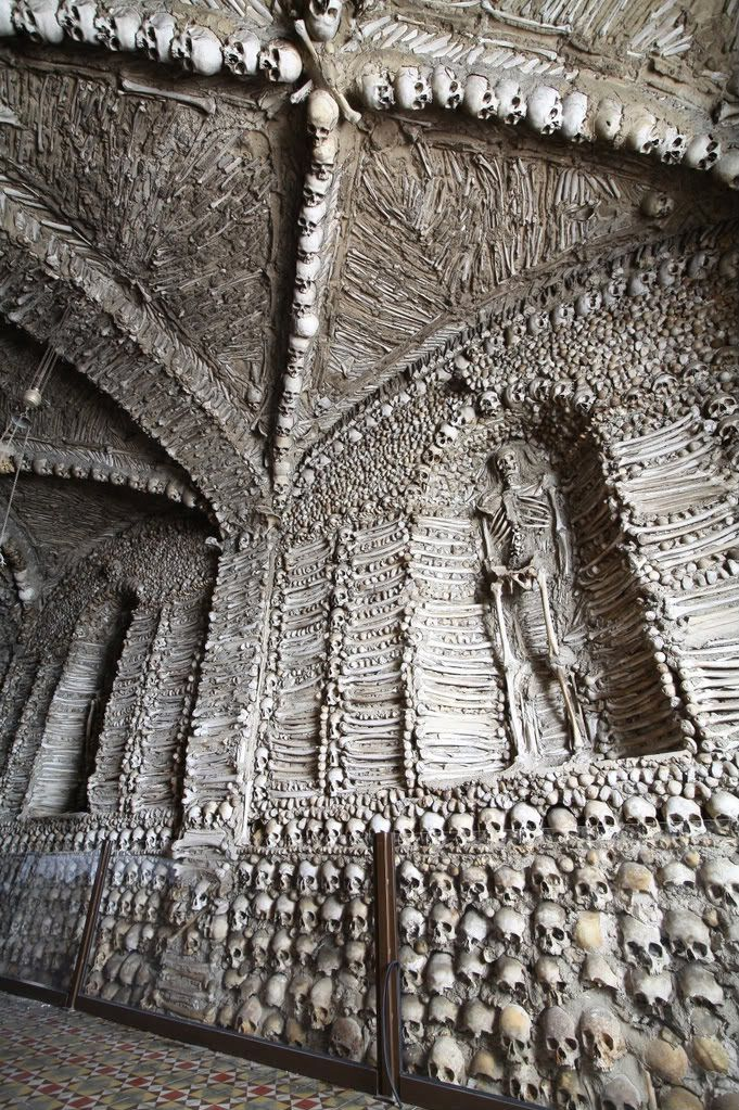 """Listed as the """"Bones Church, Evora, Portugal."""" Stacked creatively from floor to ceiling with human bones."""
