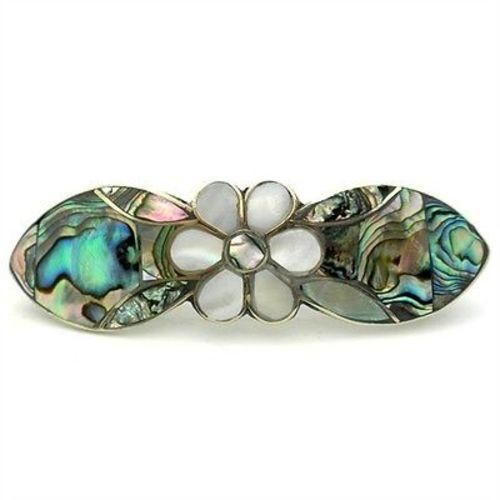 This mother-of-pearl artistically arranged in the shape of a Daisy and Abalone inlaid in alpaca silver barrette measuring 3 1/2 by 1 inch. Squeeze spring closure.