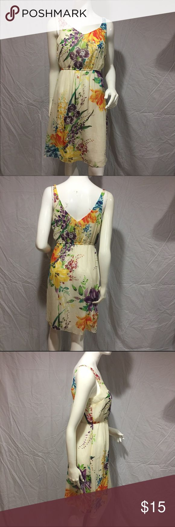 "Floral dress Cute cream colored dress with different color floral design. Has a band under the chest and is loose fitting. Front and back both have a v neckline. 31"" from the middle of the chest (bottom of V) to the bottom of dress. In great condition. Feel free to make me a reasonable offer 💕 Old Navy Dresses Midi"