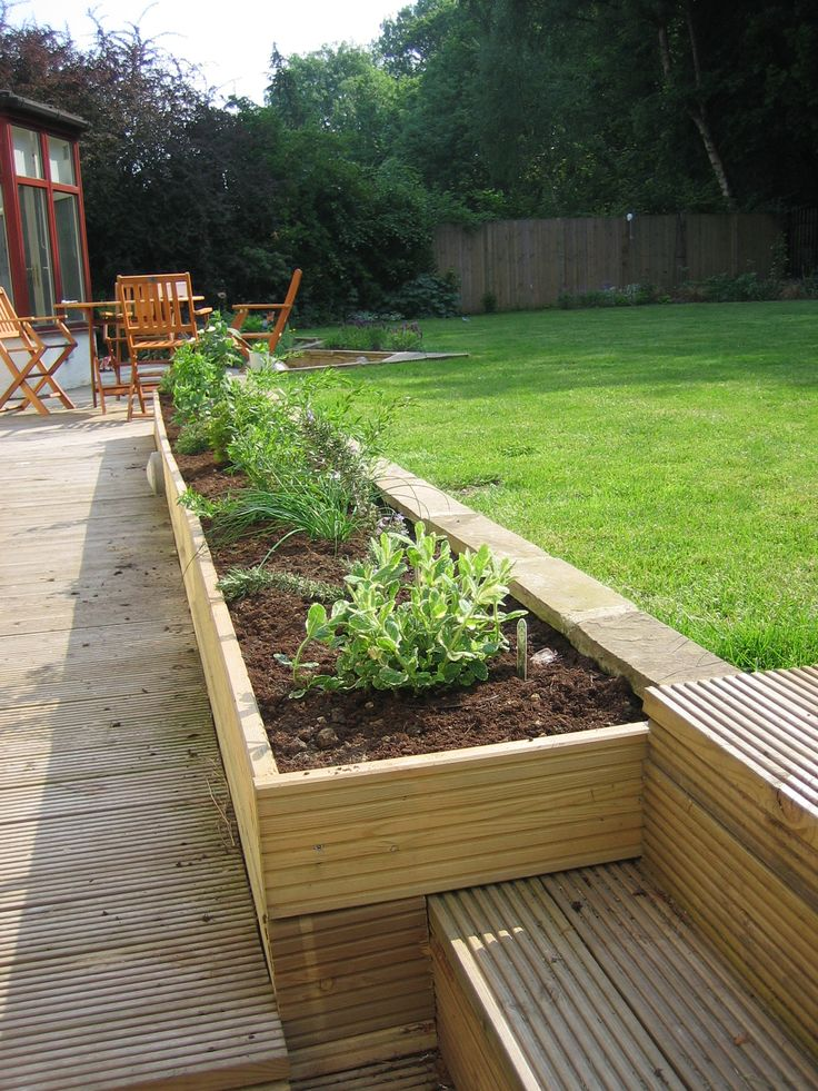 We created a herb bed with the height difference from the path to the lawn making it that bit easier to reach down and pick them.