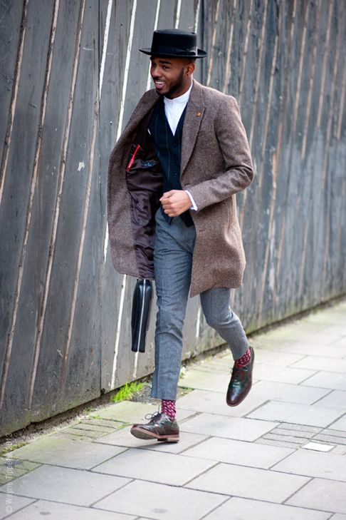 Martel Cambell dashing in Paul Smith jacket and pork pie hat.