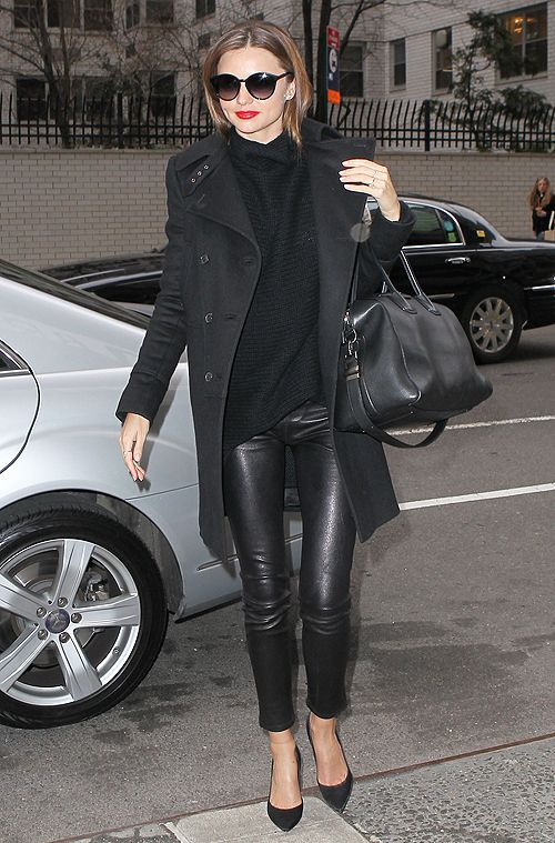 Miranda Kerr wearing a Givenchy coat, The Row sweater, a Givenchy bag, Stella McCartney sunnies & Manolo Blahnik heels.