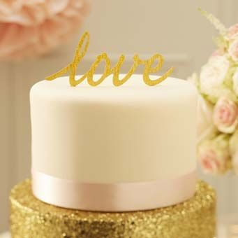 """Top your wedding cake with this stunning gold sparkle """"Love"""" cake topper."""