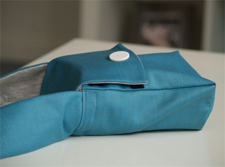 Bright Blue Denim outer Camera Bag, soft grey sweatshirt fabric inner. Velcro close on the front flap, features a removable compartment divider inside which splits the top and bottom half of the bag up so you can keep your keys/phone separate from your camera.