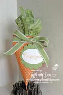 """This is a different take on the old Sour Cream Container. Using some scraps of """"green DSP"""" and attaching them to the top of the container turns this into a carrot."""