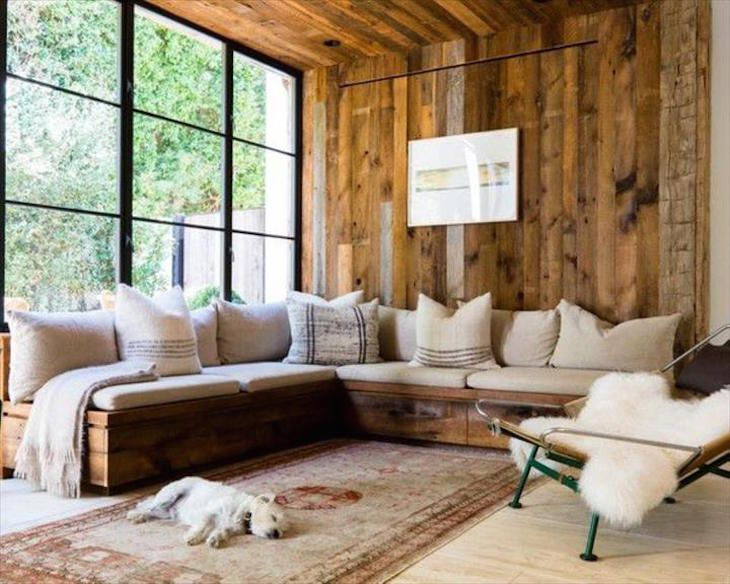 Wooden walls, wooden ceiling and a beautiful wooden sofa. To get a similar effect build your own pallet sofa, stain the wood or just use conditioner. Add lots of pillows and cushions in pastel colors and create a cozy atmosphere with warm thick blankets.