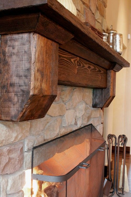 rustic looking beam for fireplace in basement