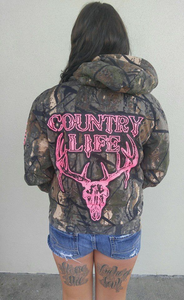 "Confess your love for camo and comfort with with cute sweatshirt! This sweatshirt is a camo print with a hot pink bon skull on the back. Down the sleeve of the left arm it says ""Country Life"". Whether"