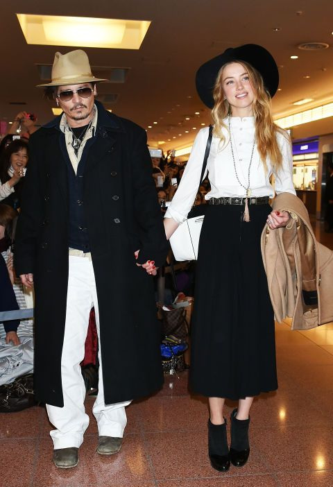 Johnny Depp and Amber Heard in 2015. See 17 more celebrity couples who dress alike.