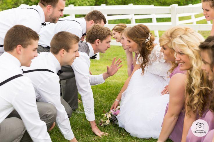 Wedding party football pose
