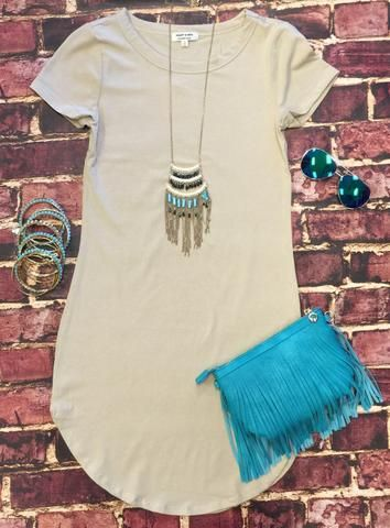 The Fun in the Sun Tunic Dress in Stone is comfy, fitted, and oh so fabulous! A great basic that can be dressed up or down! Sizing: Small: 0-3 Medium: 5-7 Large: 9-11 True to Size with a Stretchy, Fit