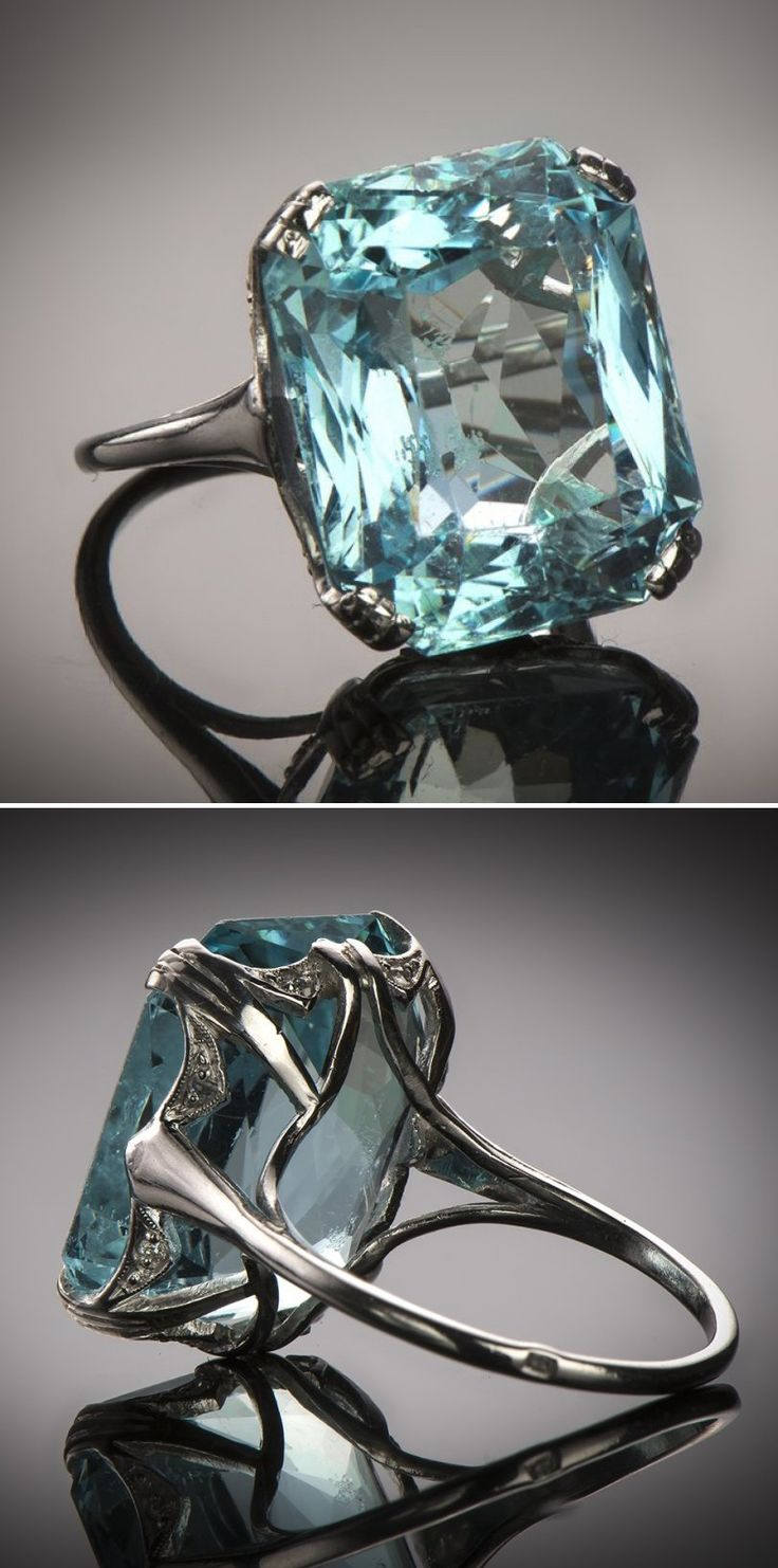 An Art Deco platinum, aquamarine and diamond ring, French, circa 1930. Set to the centre with a cushion-shaped aquamarine weighing 15 carats. #ArtDeco