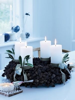 Big fat candles are sometimes more stable for an Advent wreath. Can be reused each year if they burn slowly.