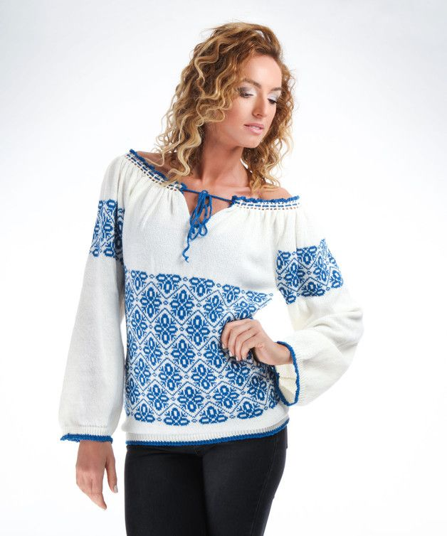 Ivory knitted Traditional Romanian Blouse with blue decorative motifs, long sleeves, and crochet details on the hems and neckline. The neckline can be adjusted with the blue braid. Romanian...