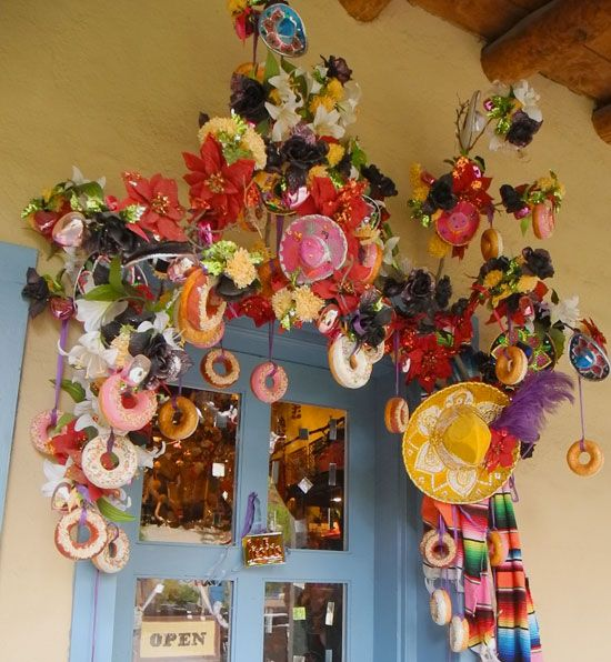 Decorated Entrance to a little gift shop in a hidden courtyard in Santa Fe, New Mexico at Christmas time.