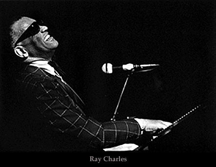 Ray Charles; I saw Ray Charles perform in concert when I was in high school and it was magical!