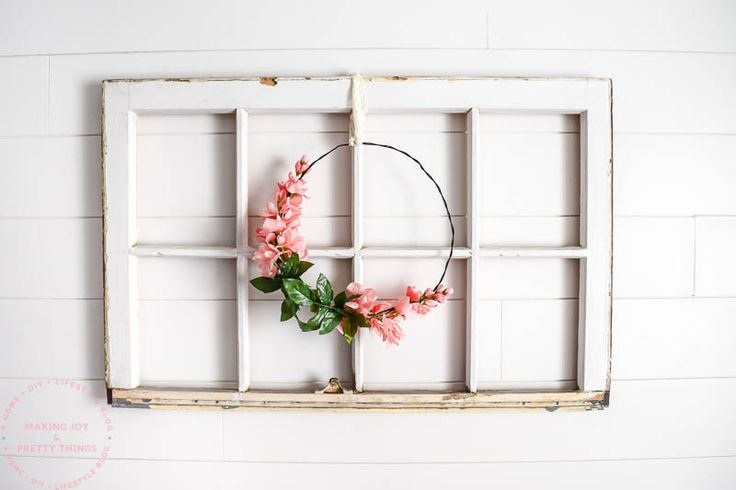 This simple floral farmhouse wreath is perfect for spring and summer and took only a few minutes to make! I love how it looks in our farmhouse nursery.