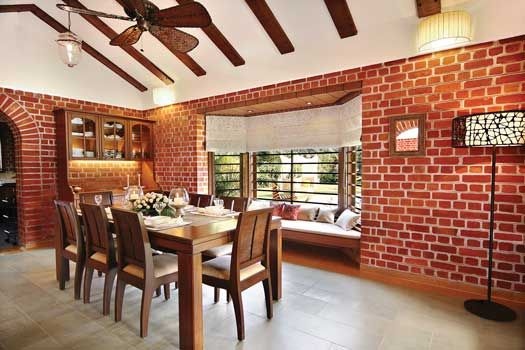 The dining room with a bay window seating overlooks the swimming pool.