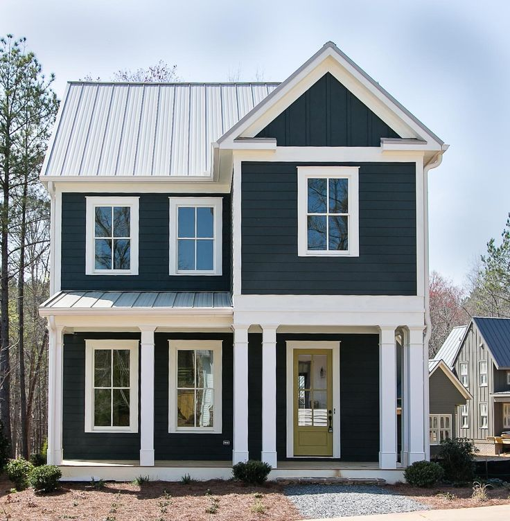 Dark paint, bright white trim, metal roof