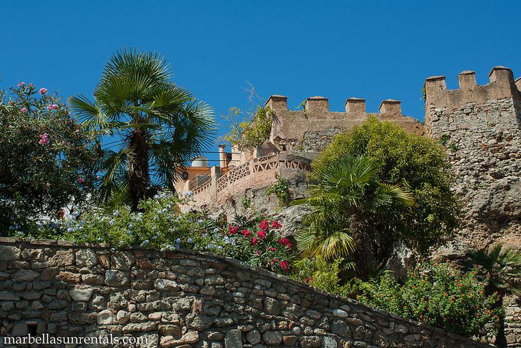 Fort, Castle wall with flowers in Old Town, Marbella