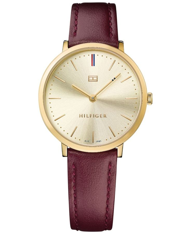 A rich burgundy leather strap adds a stylish touch to this gold-tone timepiece from Tommy Hilfiger's Sophisticated Sport collection. | Burgundy leather strap | Round gold-tone case, 35mm | Light champ