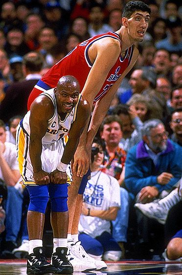 TIM HARDAWAY AND GHEORGHE MURESAN, 1994  What is so funny?