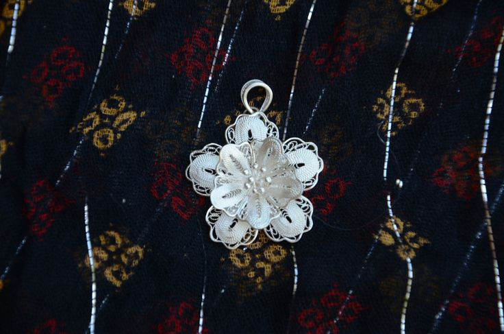 "Purchased in Istanbul, this silver Telkari pendant was handcrafted in Mardin. It is of the traditional Ottoman style jewelry and has been uniquely crafted to hold its bright silvery shine. It is 1.5"" tall and does not come with a chain."