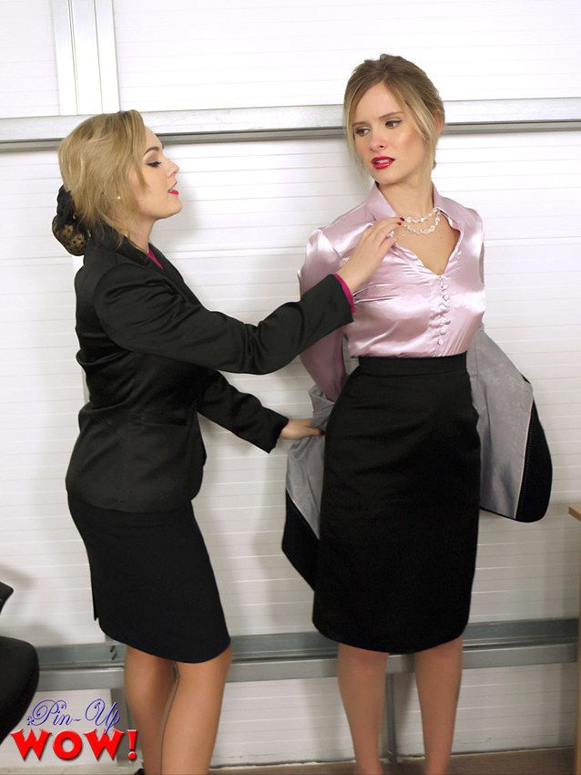Heavenly Jodie Gasson and Elle Richie striptease each other in the office Image