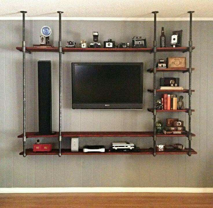 LOVE this!! Somehow leaving the floor 'open' makes the conventional tv and tv stand/cabinet pair seem very clunky.