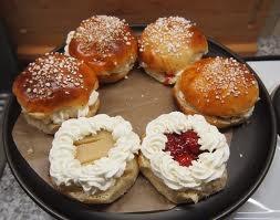 Finnish festive bun eaten during Shrovetide in February. Cream and delicious berry jam filled cardamom buns.