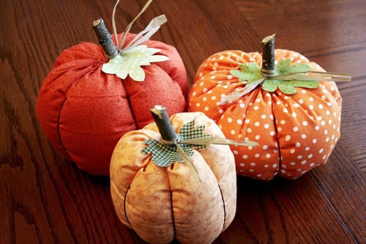 Looking for an easy DIY pumpkin? Look no further! Here's a cute way to make them out of fabric. You could even have an older child make or help make them.    To get started you'll need orange fabric (cutting instructions below), leaves cut from green fabric (felt or fleece would be ideal), 2″ piece of stick, embroidery floss, heavy duty thread and needle, a glue gun, brown or tan raffia, and a sewing machine (optional).
