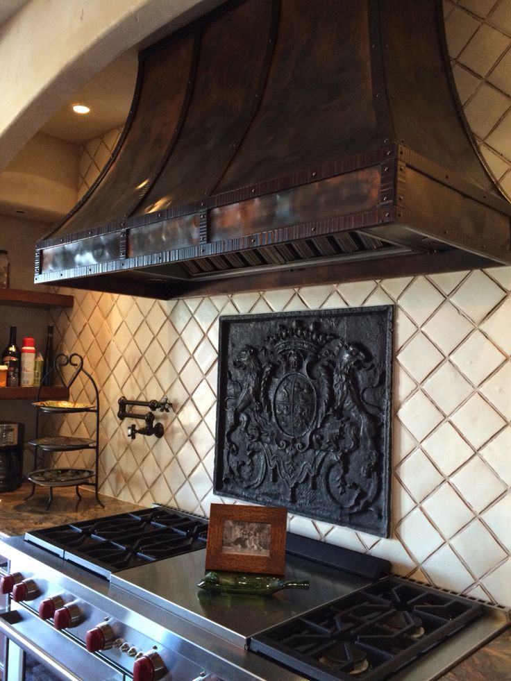 Great fireback and custom vent hood. Interior design by The Heberling Company