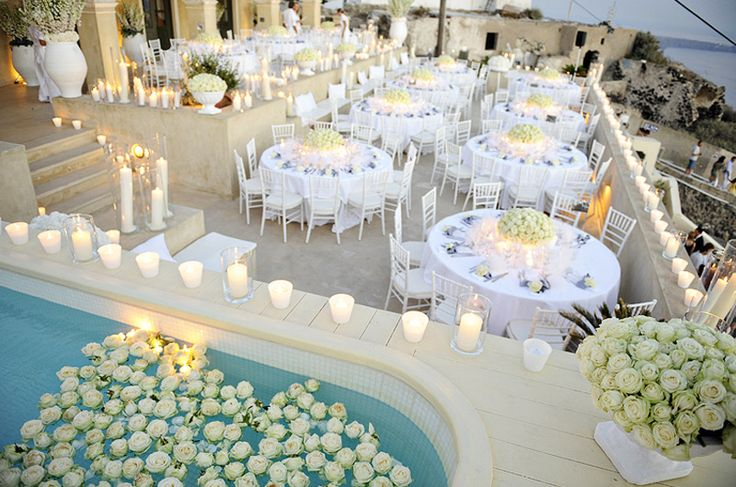 Looks gorgeous!!!!! White roses & candles in a Santorini wedding