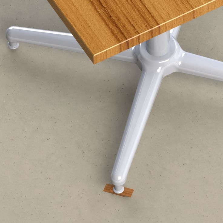 Wobbly table fixed with iWedgeIt table leg shims