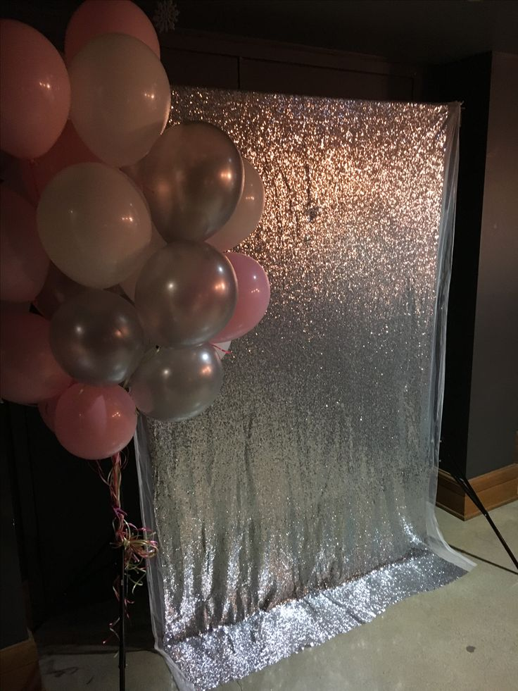 DIY Photo booth! We made this by using a photo booth backdrop frame, and 8ft piece of sequin silver fabric, and 30 balloons! Cost less than $40 :-)  #photobooth #backdrop #diy